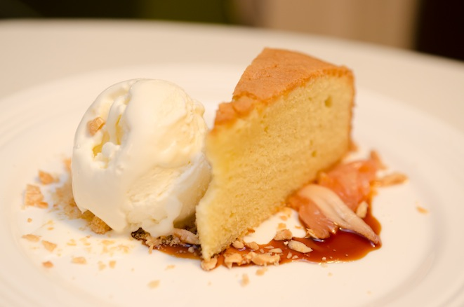 Butter–Rum Sponge Cake with Poached Rhubarb, Crème Fraîche Ice Cream, and Marcona Almonds