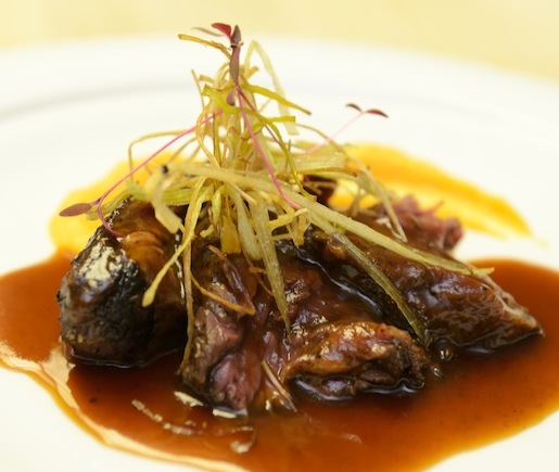 Blackened Buffalo Hanger Steak with Sweet Potato–Parsnip Custard, Apple Cider Demi-Glace, and Crispy Leeks