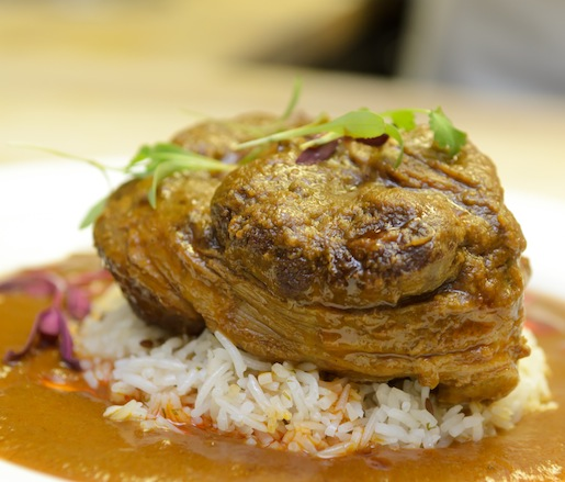 Cardamom-Spiced Lamb Shank with Caramelized Onions, White Rice, and Paratha