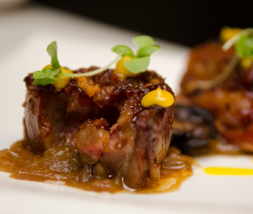 Moroccan Barbecued Lamb Belly with Harissa, Caramelized Onions, Japanese Eggplant, and Orange Curd
