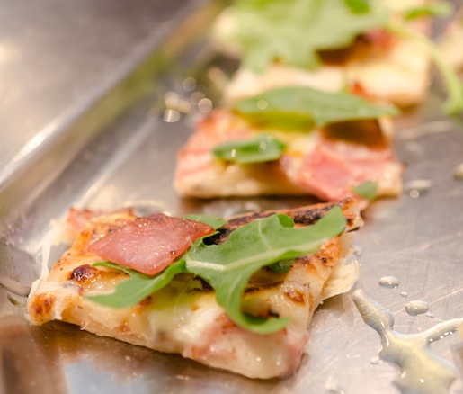 Grilled White Truffle Béchamel Pizza with Mortadella and Baby Arugula
