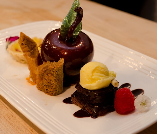 Dessert Trio > The Big Apple: Hand-Blown Sugar Apple with Volare's Signature Tiramisù, Duck Egg–Grappa Custard with Tart Montmorency Cherries and Sablé Crust, and Flourless Valrhona Chocolate Cake with Rock Hill Farms Bourbon Sauce and Saffron Gelat