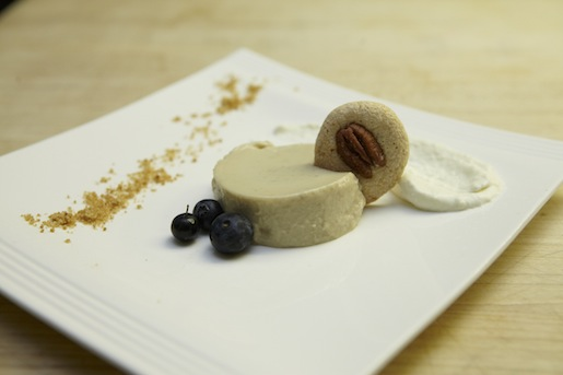 Banana Pudding Panna Cotta with Banana Bread Dust, White Chocolate Foam, and Pecan Tuile