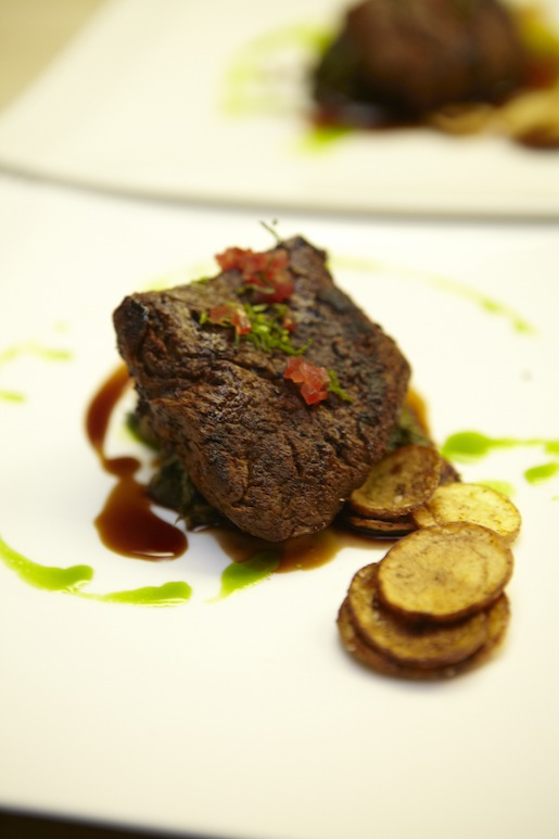 Blackened Filet Mignon with Crispy Fingerlings, Bitter Greens, and Sweet-and-Tart Cherry–Tequila Sauce