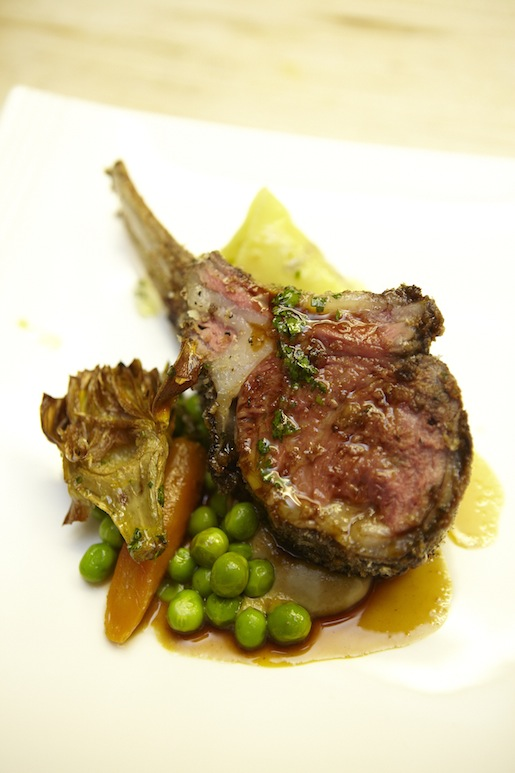 Black Garlic and Panko–Crusted Spring Lamb with Cappelletti Pasta, English Peas, Carrots, Crispy Artichoke, and Lamb Jus