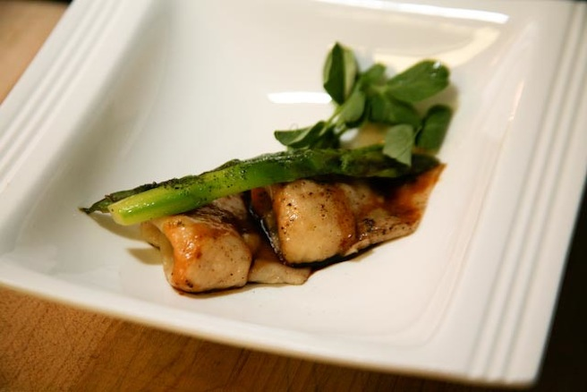 Black Pepper Crab Dumplings with Asparagus and Pea Shoots