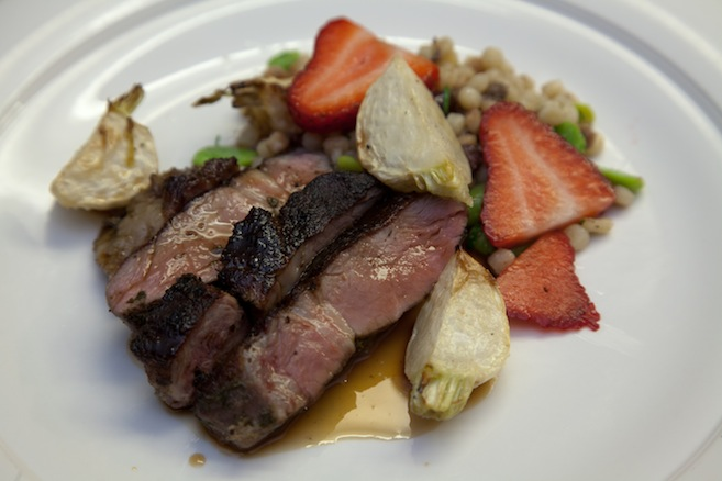 Herb-Marinated Neck Roast with Fava Beans, Turnips, Strawberries, and Toasted Fregola Sarda