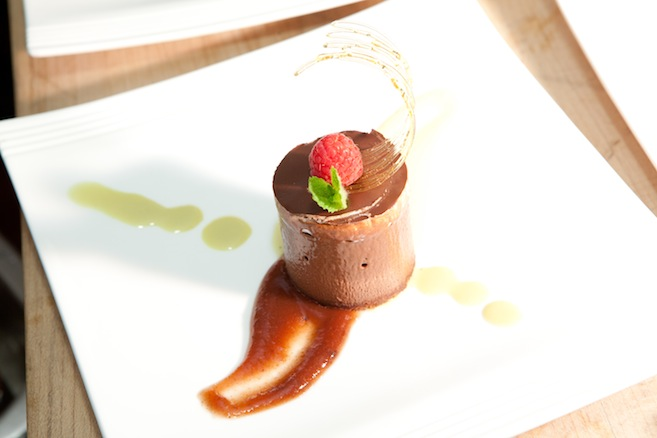 Chocolate–Pistachio Torte with Candied Pistachios, Quince Purée, Tahitian Vanilla Bean Crème Anglaise, and Chocolate Sauce