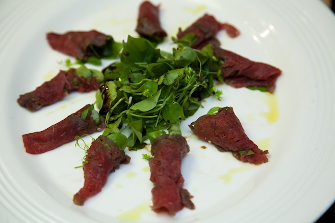 Buffalo Carpaccio with Dried Tomato Confit, Preserved Meyer Lemon, and Miner's Lettuce
