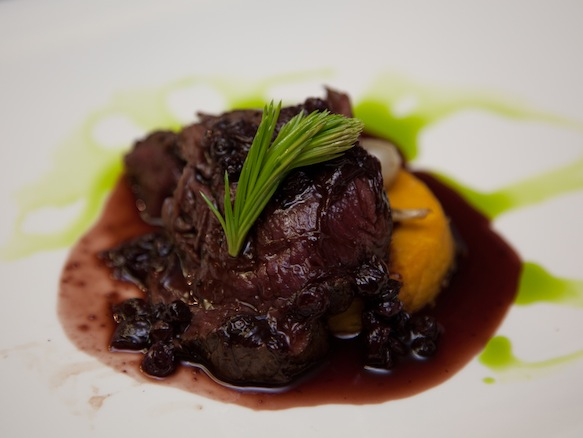 Elk Tenderloin with Pink Peppercorns, Huckleberries, Icewine, Ramps, and Sweet Potato Flan