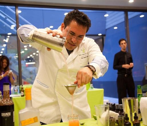Junior Merino making his El Angel cocktail