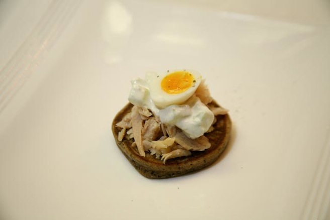Black Hills Smoked Trout on Buckwheat Pancake with Cucumber–Horseradish Raita and Quail Egg