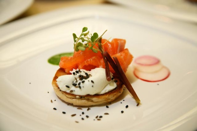 Sockeye Salmon on Everything Bagels with Goat-Milk Cream Cheese, Ramp Purée, and Pickled Radishes