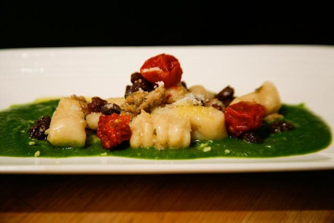Ricotta Gnudi with Chicken–Arugula Sausage, Raisins, Stewed Tomatoes, and Rapini Purée