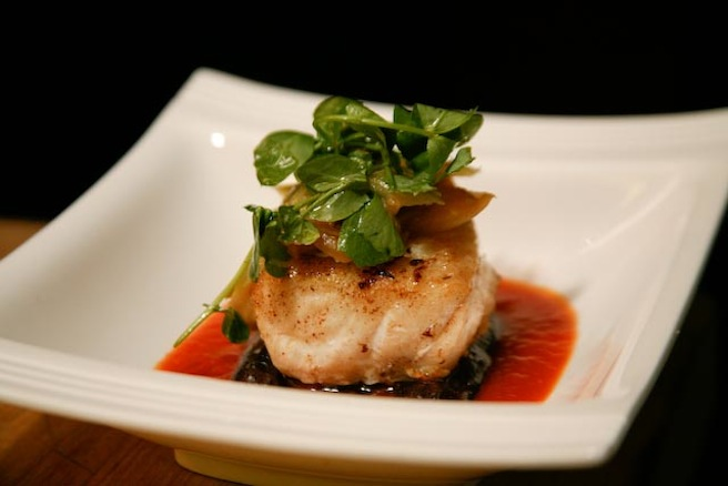 Pan-Seared Grouper with Purple Fingerling Potatoes, Caramelized Fennel and Cardoons, Pea Shoots, and Saffron–Tomato Broth