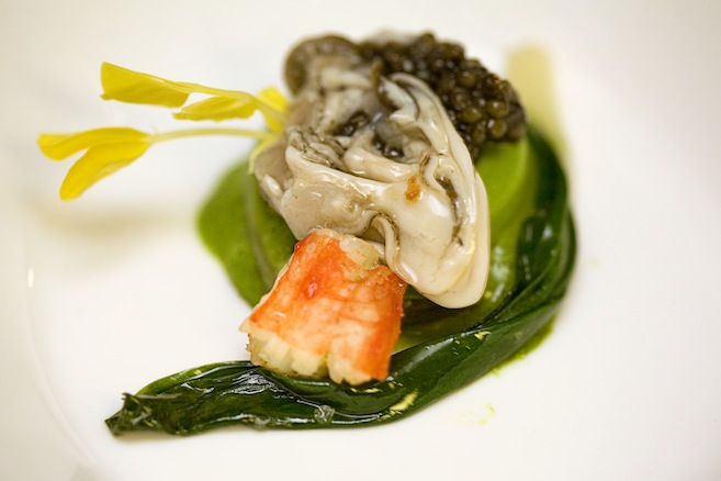 Alaskan King Crab Nage with Ramp Panna Cotta, Osetra Caviar, and Kumamoto Oysters