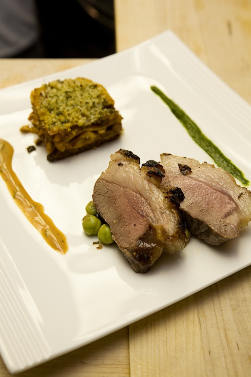 Roasted Lamb Loin with Braised Lamb Lasagna, Chickpeas, Green Olives, Sun-Dried Tomatoes, and Aromatic Honey–Yogurt Sauce