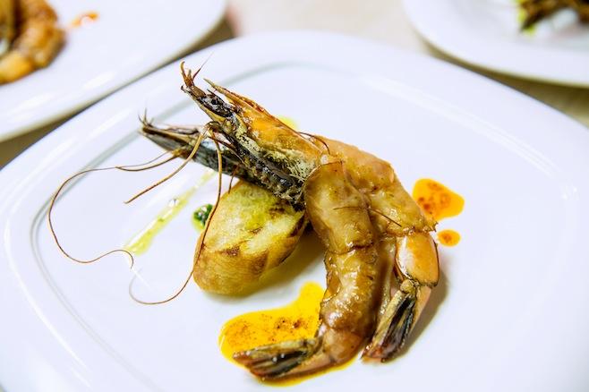 Housemade Lomo–Wrapped Marvesta Shrimp with Pistou, Smoked Paprika Vinaigrette, and Grilled Bread