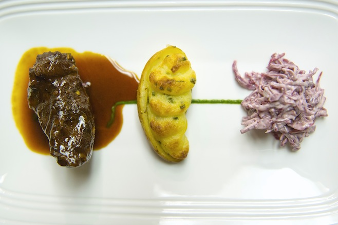 White Wine–Braised Pork Cheeks with Twice-Baked Fingerlings, Chive Purée, and Slow-Roasted Tomatoes