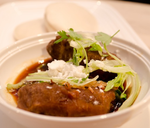 Spiced Palm Sugar–Braised Pork Cheeks with Steamed Buns and Truffle Powder