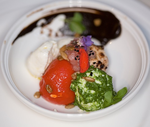Mozzarella Salad with Charred Yellow Tomato Broth, Black Garlic, Herbs, and Seeds