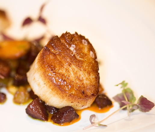 Seared Scallop with Sweet Organic Carrots, Curry, Golden Raisins, and Pine Nuts