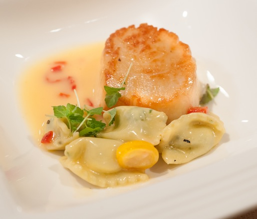 Seared Scallops with Arugula Agnolotti, Piquillo Peppers, and Kumquats