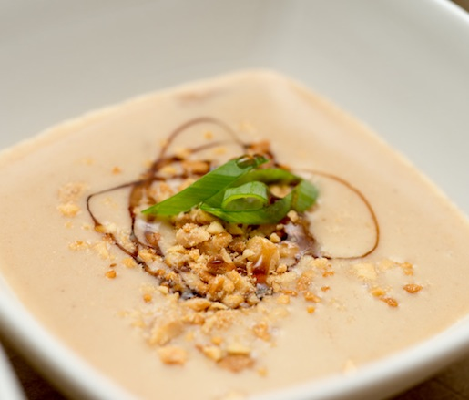 Peanut Soup with Grilled Peaches, Toasted Peanuts, Sugarcane Vinegar, and Scallions