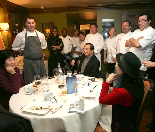 Chefs with guests after a successful service