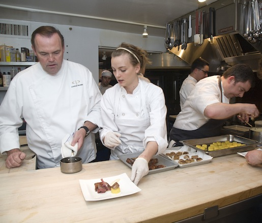 Chef Charlie Palmer, Chef Marcus Gleadow Ware, and members of their team in the Beard House kitchen
