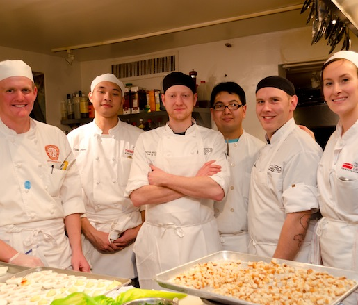 Chefs Patrick McCandless and Tyler Powell with members of their team in the Beard House kitchen