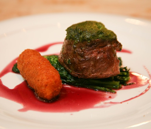 Bone Marrow–Crusted Beef Tenderloin with Garlic Confit–Sautéed Rapini, Gorgonzola–Potato Torta, and Winter-Spiced Red Sauce
