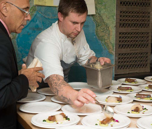 Chef Bryan Votaggio plating in the Beard House kitchen