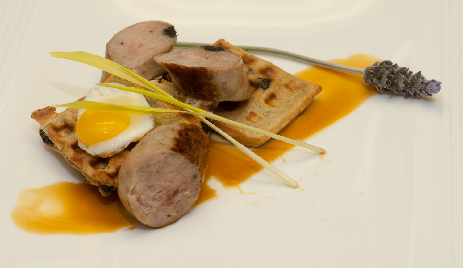 Game Bird Sausage on Dried Blueberry Waffle with Lavender-Infused Sorghum and Fried Quail Egg