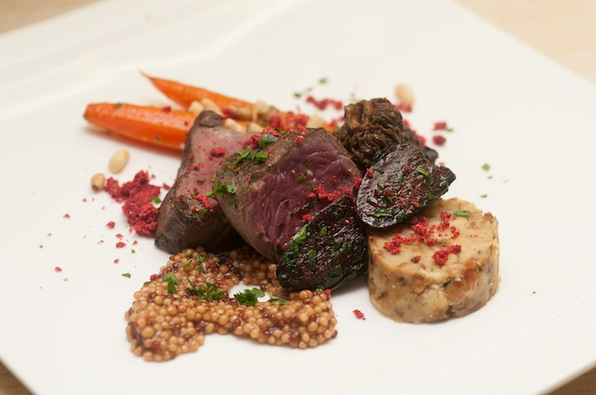 Volcanic > Sous Vide Wapiti Elk Strip Loin with Duck Heart Confit, Alder-Smoked Morels, Baby Carrots, Semmelknoedel, Ice Axe IPA–Poached Mustard Seeds, Pine Nuts, and Raspberry Soil