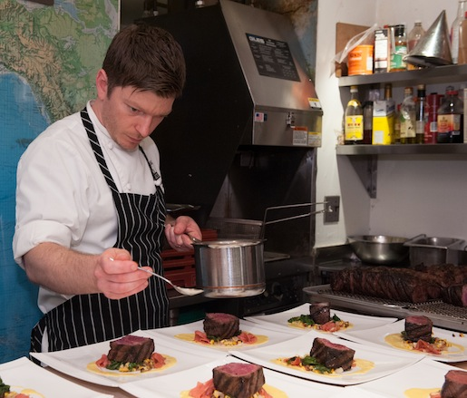 Ben Roche garnishing his Wagyu Flatiron Steaks