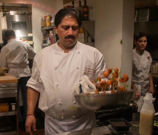 Vikram Sunderam preparing a dish in the Beard House kitchen