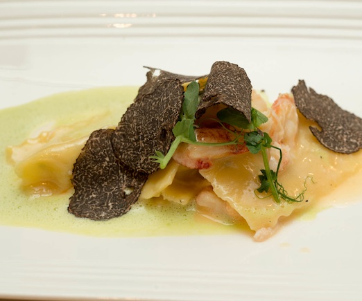 Sweet Corn Agnolotti with Périgord Truffles, Peekytoe Crab, Parmesan Fondue, Sweet Pea Emulsion, and Pea Tendrils