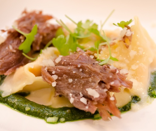 Sweet Potato Agnolotti with Duck Confit and Mustard Greens