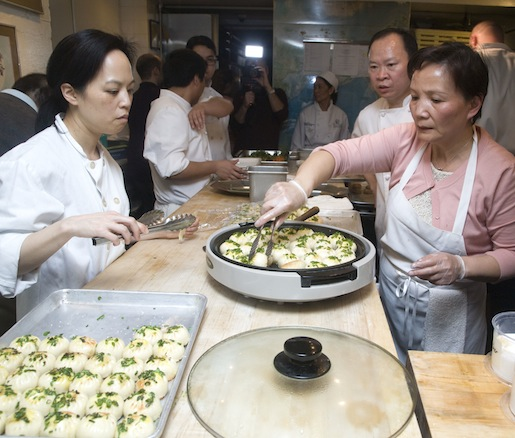 Chef Peter Chang supervizes his team plating baozi
