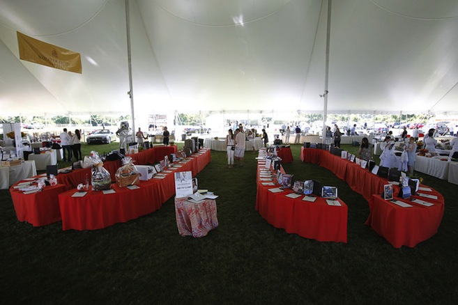Travel, dining, and other culinary goodies up for auction under the tent