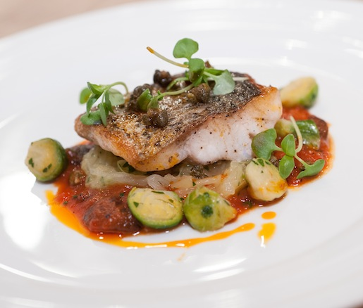 Roasted Striped Bass with Spaghetti Squash, Brussels Sprouts, and Warm Tomato–Caper Vinaigrette