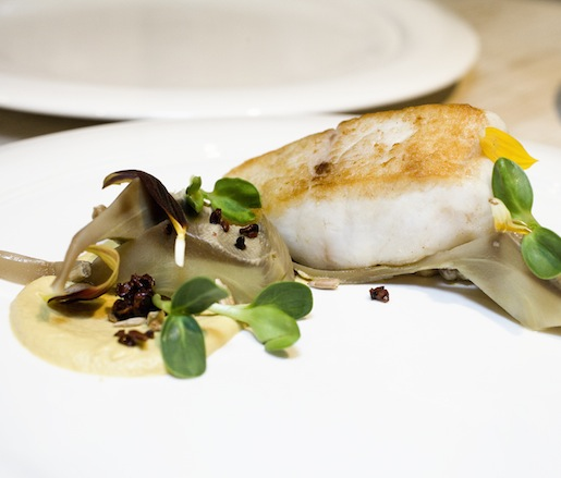 Wild Striped Bass with Artichokes, Sunflower Seed Purée, Pearled Barley, and Sunflower Sprouts