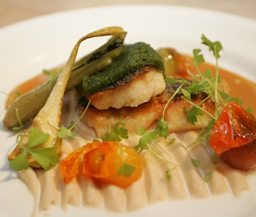 Herb-Crusted Carolina Striped Bass with White Bean Purée, Fennel, Artichokes, and Tomato Confit