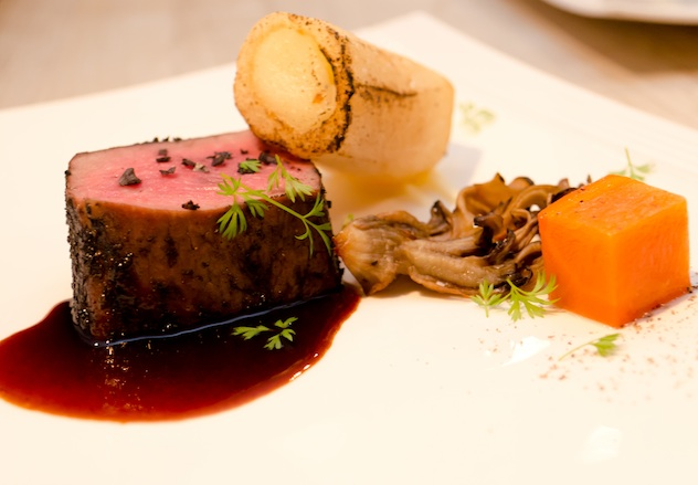Pittsburgh-Style Grassfed Beef with Bone Marrow Butter, Hen of the Woods Mushrooms, Carrot Confit, and Black Garlic Jus