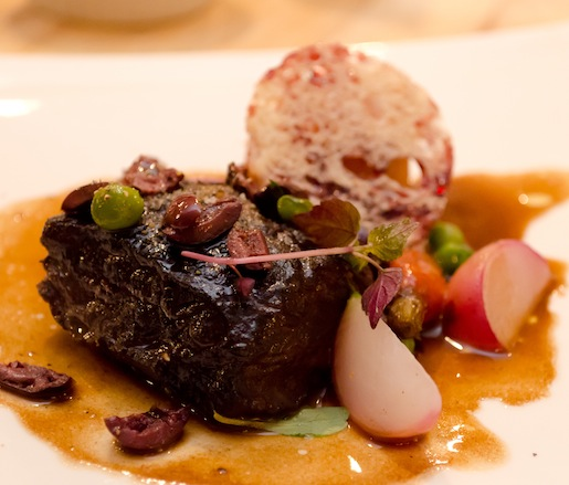 Slow-Braised Wagyu Beef Cheeks with Seasonal Garden Vegetables, Chickpeas, Taggiasca Olives, Croquant Sauvignon, and Pensato Citrino Oil