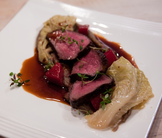 Triple-Seared Bison Strip Loin with Savoy Cabbage, Kohlrabi, Lentil Sauce, and Bison Tongue