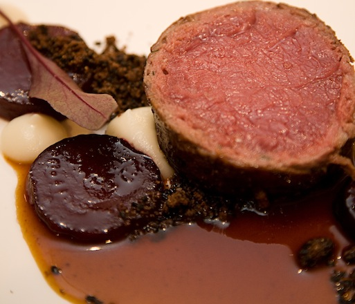 Sausage-Wrapped Bison Loin Salt-Roasted Beets, Strawberry–Rhubarb Preserves, Sesame, and Celery Root Purée