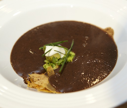 Black Bean–Mexican Chocolate Bisque with Pasilla Chilies, Grilled Avocado Relish, White Chocolate–Laced Mexican Crema, and Pasilla Chile–Infused Wafer