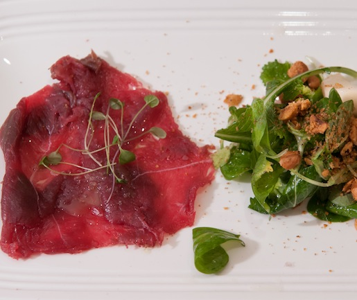Cold-Smoked Venison Carpaccio with Spruce Oil, Pickled Turnip Salad, and Spiced Hazelnuts